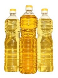Bottle of vegetable oil on a white background.
